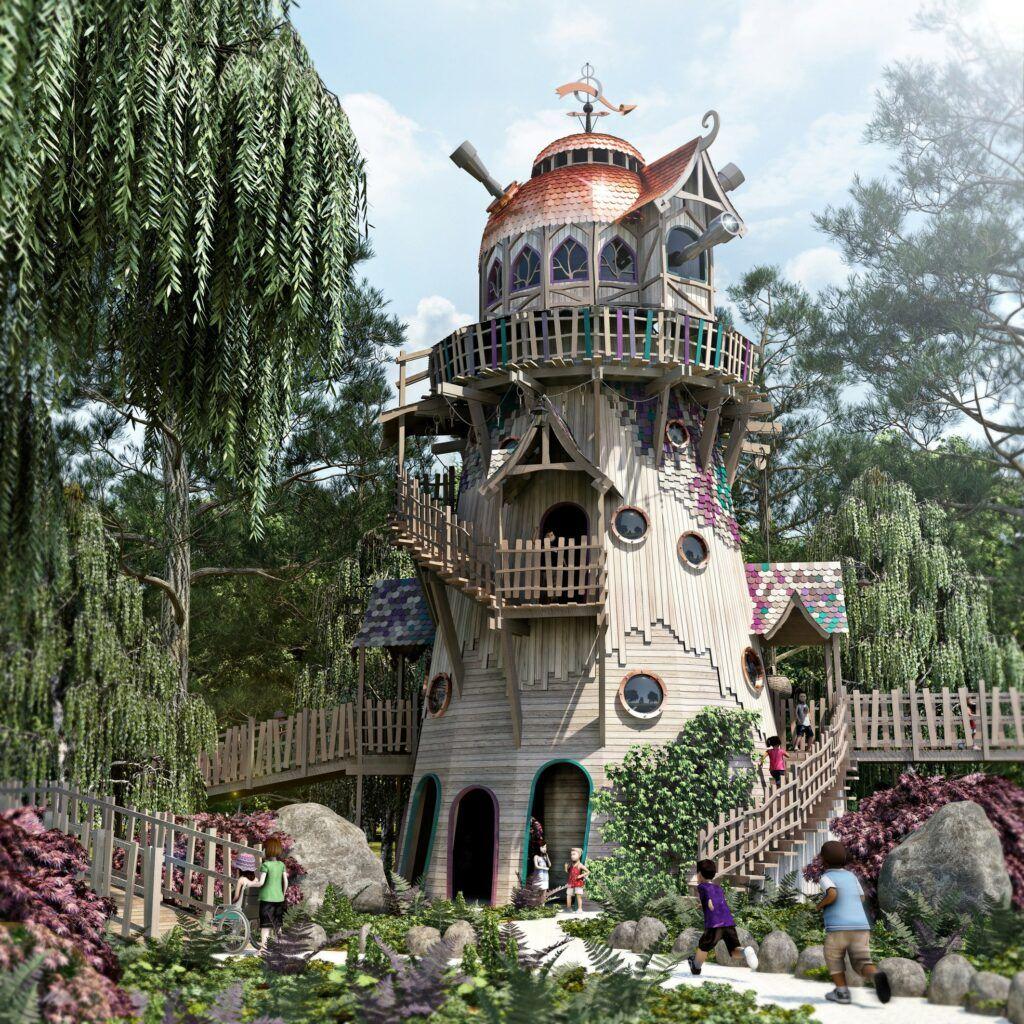 Ett högt trätorn byggt för lek med kikare och vindlande gångar